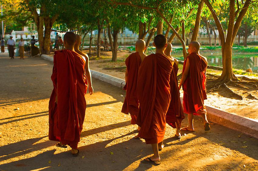 Buddhist monks walking outside Kuthodaw Pagoda, Mandalay, Burma