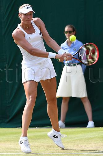 July 6th 2017, All England Lawn Tennis and Croquet Club, London, England; The Wimbledon Tennis Championships, Day 4;  Yanina Wickmayer of Belgium returns to Garbine Muguruza (ESP)