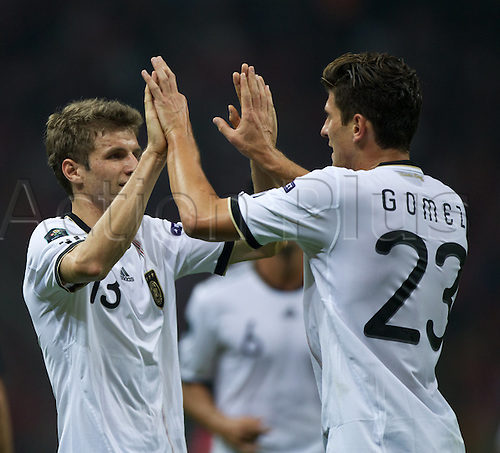 07.10.2011 Istanbul Turkey.  Germany's Mario Gomez (R) and Thomas Mueller (L) celebrates after Gomez scored the 1-0 during the EURO 2012 qualifying match between Turkey and Germany at the Turk Telekom Arena.