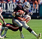 Oakland Raiders vs. Chicago Bears at Oakland Alameda County Coliseum Sunday, September 26, 1999.  Raiders bet Bears  24-17.  Chicago Bears defensive back Terry Cousin (21) tackles Oakland Raiders wide receiver Tim Brown (81).