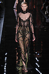 """Model walks runway in an embroidered black dress with draped tulle overlay from the Reem Acra Fall 2016 """"The Secret World of The Femme Fatale"""" collection, at NYFW: The Shows Fall 2016, during New York Fashion Week Fall 2016."""