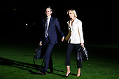 Senior Advisor to President Trump Jared Kushner (L) and his wife Ivanka Trump (R), daughter of President Trump, walk on the South Lawn after returning to the White House by Marine One, in Washington, DC, USA, 18 October 2019. The couple joined President Trump during a trip to Texas.<br /> Credit: Michael Reynolds / Pool via CNP
