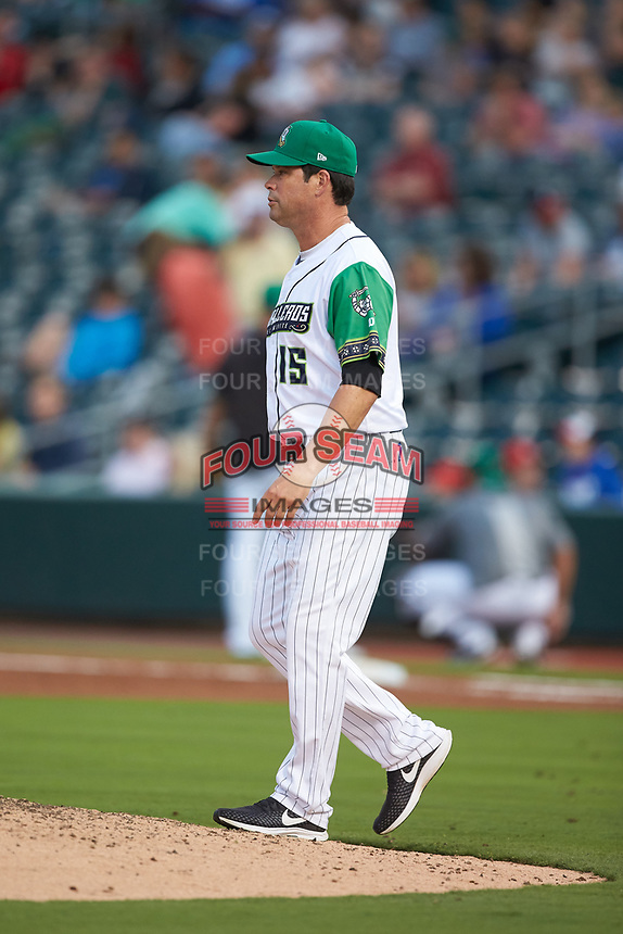 Caballeros de Charlotte manager Mark Grudzielanek (15) walks to the mound to make a pitching change during the game against the Buffalo Bisons at BB&T BallPark on July 23, 2019 in Charlotte, North Carolina. The Bisons defeated the Caballeros 8-1. (Brian Westerholt/Four Seam Images)