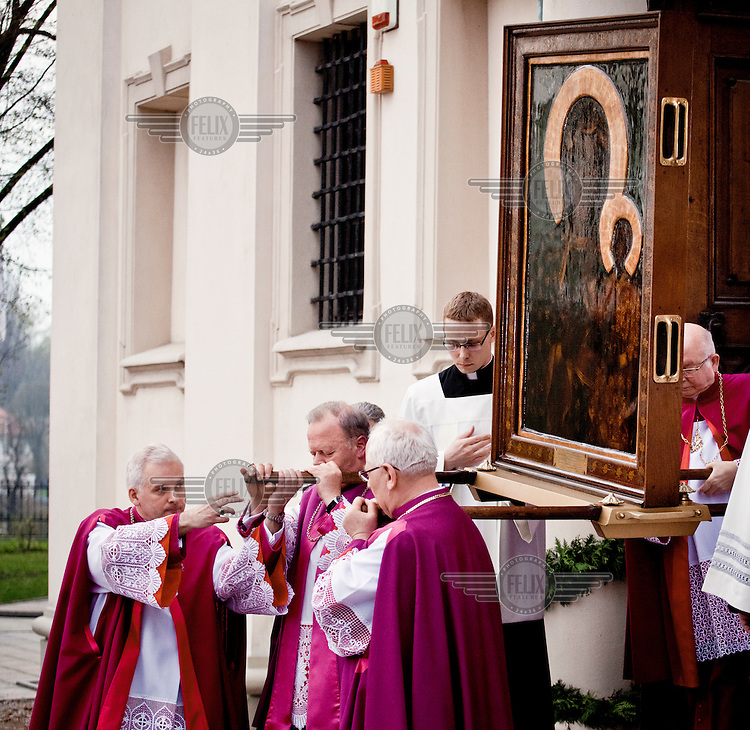 Priests carry a replica of a Black Madonna painting from Gniezno Cathedral following a mass on the 1050 anniversary of the Polish adoption of Catholicism (the Baptism of Poland).