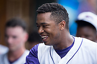 Eloy Jimenez (27) of the Winston-Salem Dash is all smiles after hitting a home run against the Salem Red Sox at BB&T Ballpark on July 23, 2017 in Winston-Salem, North Carolina.  The Dash defeated the Red Sox 11-10 in 11 innings.  (Brian Westerholt/Four Seam Images)