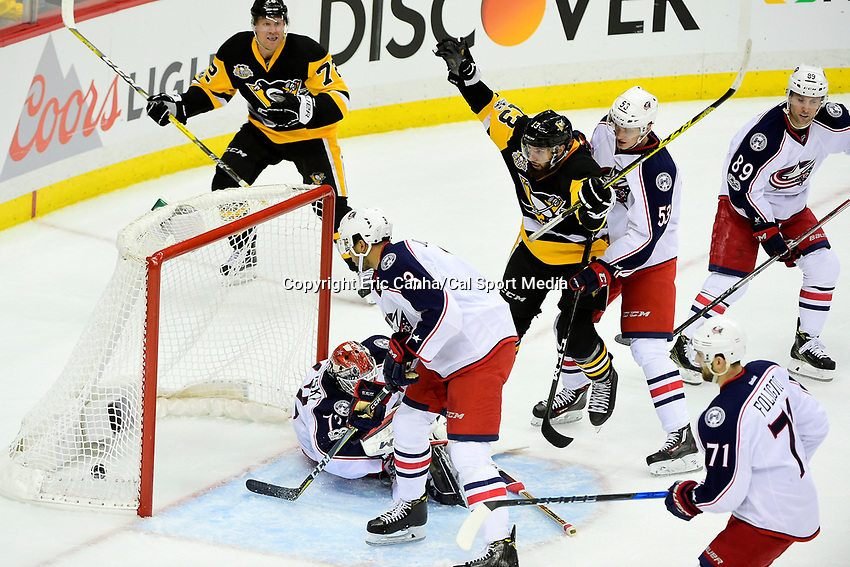 Wednesday, April 12, 2017: Pittsburgh Penguins center Nick Bonino (13) reacts to a goal during game 1 of round one of the National Hockey League Eastern Conference Stanley Cup Playoffs between the Columbus Blue Jackets and the Pittsburgh Penguins, held at PPG Paints Arena, in Pittsburgh, PA.  Pittsburgh defeats Columbus 3-1. Eric Canha/CSM