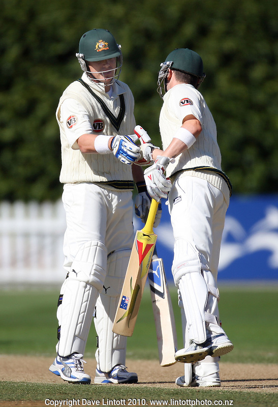 Australia's Marcus North and Michael Clarke celebrate passing 150 runs in their batting partnership during day two of the 1st cricket test match between the New Zealand Black Caps v Australia, day two at the Basin Reserve, Wellington, New Zealand on Saturday, 20 March 2010. Photo: Dave Lintott / lintottphoto.co.nz