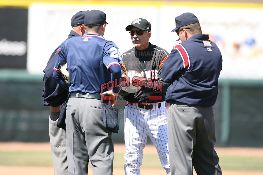 April 15th 2008:  Manager Tom Brookens (16) of the Erie Seawolves, Class-AA affiliate of the Detroit Tigers, argues a home run call with umpires Mark Lollo (left), Shaun Francis (middle), and Brad purdom (right) during a game at Jerry Uht Park in Erie, PA.  Photo by:  Mike Janes/Four Seam Images