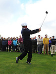 Members look on as club professional Bobby Browne Tees off at the Captain's Drive In at Laytown & Bettystown Golf Club. Photo: Colin Bell/pressphotos.ie