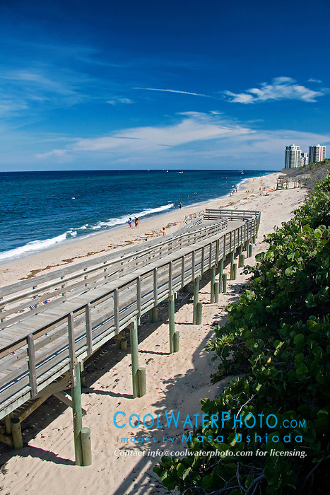 boardwalk to beach, John D. MacArthur Beach State Park, high-rise condominiums and hotels on Singer Island in distance, North Palm Beach, Florida, Atlantic Ocean