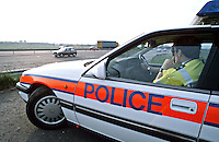 Traffic police officers with their police emergency rapid response traffic vehicle parked on the raised bank on the side of the motorway...© SHOUT. THIS PICTURE MUST ONLY BE USED TO ILLUSTRATE THE EMERGENCY SERVICES IN A POSITIVE MANNER. CONTACT JOHN CALLAN. Exact date unknown.john@shoutpictures.com.www.shoutpictures.com..