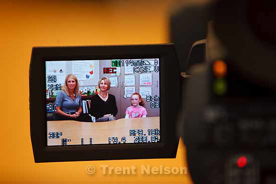 Parents Angie Parkin (left) and Shelly Roderick are interviewed by student Mary Hanks. Students at Dilworth Elementary are producing a short film about their teacher, Sharon Gallagher-Fishbaugh, who is one of five finalists for the NEA Foundation's Awards for Teaching Excellence. Students worked on the project Tuesday, November 3 2009.
