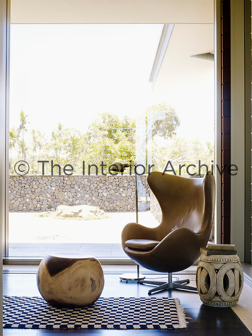 A leather Egg chair strikes a vintage note in a corner of the living room