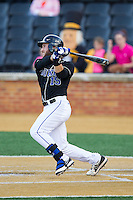 Mike Rosenfeld (15) of the Duke Blue Devils follows through on his swing against the Wake Forest Demon Deacons at Wake Forest Baseball Park on April 25, 2014 in Winston-Salem, North Carolina.  The Blue Devils defeated the Demon Deacons 5-2.  (Brian Westerholt/Four Seam Images)