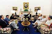 United States President Bill Clinton meets in the Oval Office on July 22, 1995 with (from left to right) CIA Deputy Director George Tenet; Chief of Staff Leon Panetta;  National Security Advisor Anthony Lake; US Secretary of State Warren Christopher; Chairman of the Joint Chiefs of Staff General John Shalikashvili; US Ambassador to the United Nations Madeline Albright and US Deputy Secretary of Defense John White.<br /> Mandatory Credit: Robert McNeely / White House via CNP