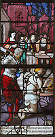 One of Saints Crispin and Crispinian, patron saints of cobblers, about to be beheaded by a soldier with a sword, from the Scenes of the Life and Martyrdom of Saints Crispin and Crispinian stained glass window, attributed to Nicolas le Prince, donated in 1530 by the cobblers guild in Gisors, in the Collegiate Church of Saint-Gervais-Saint-Protais, built 12th to 16th centuries in Gothic and Renaissance styles, in Gisors, Eure, Haute-Normandie, France. The church was consecrated in 1119 by Calixtus II but the nave was rebuilt from 1160 after a fire. The church was listed as a historic monument in 1840. Picture by Manuel Cohen