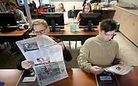 NWA Democrat-Gazette/DAVID GOTTSCHALK Aidan Killian (left) and Jonathan Kellar, both seventh grade students at Ramay Junior High School review an edition of the Northwest Arkansas Democrat-Gazette Thursday, March 8, 2018, in Rachel Cogburn's Green Architecture class in Fayetteville. Black Hills Energy renewed their $2,500 to sponsor the Newspapers in Education program.