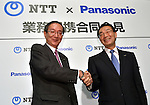 June 17, 2015, Tokyo, Japan - Presidents Kazuhiro Tsuga, right, of Panasonic and Hiroo Unoura of NTT shake hands after announcing buisiness tie-up during a news conference in Tokyo on Wednesday, June 17, 2015. The two Japanese companies will join to develop next-generation information systems ahead of the 2020 Tokyo Olympics, including 3-D video distribution systems for broadcasting sports events. Panasonic's technologies for shooting and processing 3-D video will be combined with NTT's high-speed communications technologies. (Photo by Natsuki Sakai/AFLO) AYF -mis-