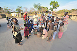 Children--and a few of their mothers--gather to sing and dance in the Southern Sudan village of Yondoru. Families here are rebuilding their lives after returning from refuge in Uganda in 2006 following the 2005 Comprehensive Peace Agreement between the north and south. NOTE: In July 2011, Southern Sudan became the independent country of South Sudan