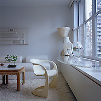 The guest bedroom doubles as a study and television room with a bespoke acrylic desk mounted on the windowsill