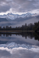 Lake Matheson with reflections of Mt. Cook and Mt. Tasman at twilight, Westland National Park, West Coast, New Zealand