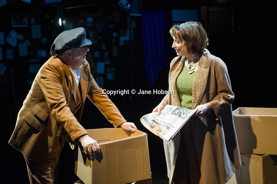 London, UK. 21.02.2014. THE A TO Z OF MRS P has its world premiere at Southwark Playhouse.  The story behind the handy, all-purpose, pocket-sized A-Z Street Guide is written by Diane Samuels (book) and Gwyneth Herbert (music and lyrics). <br />  Starring ISY SUTTIE (Peep Show / Shameless) in her first musical, as the pioneering Mrs P; with Tony Award winner FRANCES RUFFELLE (Les Miserables, Pippin, Piaf) as her emotionally fragile mother; and Olivier Award winner MICHAEL MATUS (Martin Guerre, The Baker's Wife, The Sound Of Music) as Phyllis&rsquo;s beloved and impossible father, the map publisher Sandor Gross. Directed by Sam Buntrock. Picture shows: Ian Caddick and Isy Suttie (Mrs P). <br /> Photograph &copy; Jane Hobson.