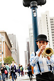 USA, California, San Francisco, the Embarcadero,  a young street performer, Gabriel Angelo plays the trumpet outside the Ferry Building