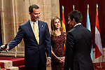 Spain's Crown Prince Felipe (L) and Princess Letizia give a medal to Spanish golfer Jose Maria Olazabal, laureate of the 203 Prince of Asturias Award for Sports, during an official audience at the Reconquista Hotel in Oviedo, Spain. October 25, 2013..(ALTERPHOTOS/Victor Blanco)