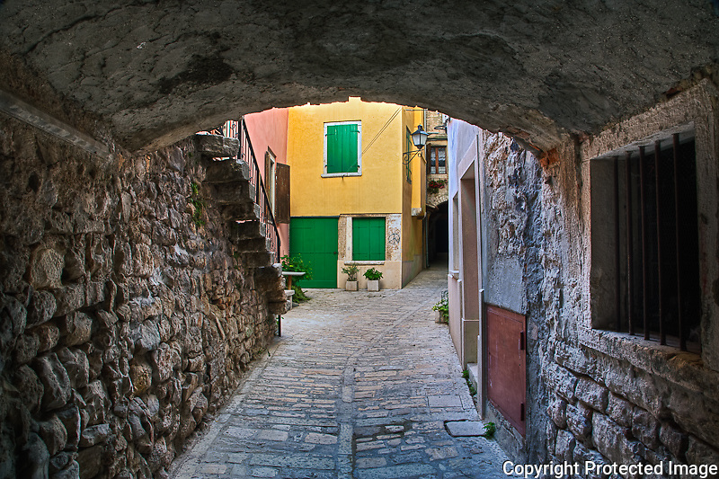 Arched alley of cobblestones, Rovigno, Croatia