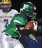 Farmingdale running back No. 30 Jordan McLune rushes for an 82-yard touchdown during a Nassau County varsity football Conference I semifinal against East Meadow at Hofstra University on Saturday, Nov. 14, 2015. He totaled four touchdowns and 214 yards on the ground in Farmingdale's 41-13 win.<br /> <br /> James Escher