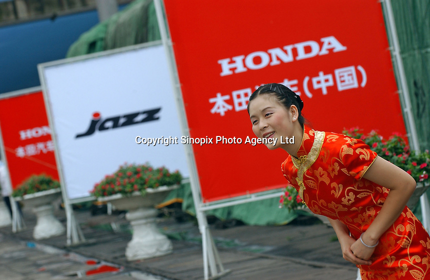A model at a ceremony at Guangzhou port by the Honda Motor (China) Export plant in Guangzhou, China, as the first Honda Jazz cars produced in China are exported.  The new Honda plant will produce and export the Honda Jazz model..