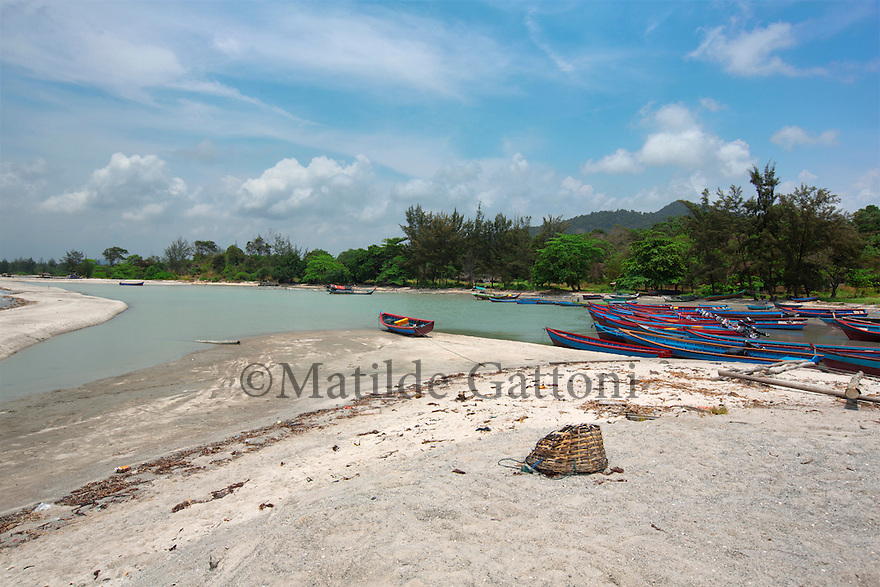 Indonesia - Bangka Island - Rebo - Rebo's beach was once considered one of the most beautiful beaches of Bangka Island but after years of tin mine exploitation the once turquoise water has turned into a brown pond surrounded by white toxic sand.