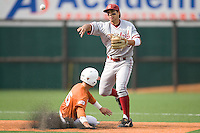 Stanford shortstop Kenny Diekroeger (3) turns a double play against the Texas Longhorns on March 4th, 2011 at UFCU Disch-Falk Field in Austin, Texas.  (Photo by Andrew Woolley / Four Seam Images)