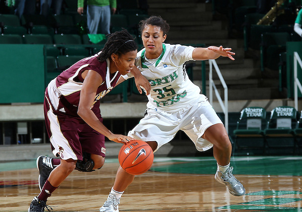Denton, TX - NOVEMBER 12: Loryn Goodwin #35 of the University of North Texas Mean Green guards Taylor McGilbar #14 of Texas State Bobcats at the Super Pit in Denton on November 12, 2012 in Denton, Texas. (Photo by Rick Yeatts)