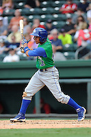 Second baseman Ramon Torres (12) of the Lexington Legends bats in a game against the Greenville Drive on Friday, August 18, 2013, at Fluor Field at the West End in Greenville, South Carolina. Lexington won, 5-0. (Tom Priddy/Four Seam Images)