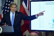Washington, DC - October 8, 2014: U.S. Secretary of State John Kerry points to slide as he addresses the U.S. and U.K. response to the Ebola crisis during a joint press availability with U.K. Foreign Secretary Philip Hammond in the Treaty Room at the Department of State, October 8, 2014.   (Photo by Don Baxter/Media Images International)