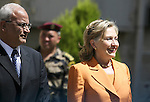 U.S Secretary of State Hillary Rodham Clinton, right, smiles to journalists as she walks next to Chief Palestinian negotiator Saeb Erekat, prior to a meeting with Palestinian President Mahmoud Abbas, in the West Bank city of Ramallah on Sept. 16, 2010. After two days of inconclusive Mideast peace negotiations, Clinton traveled Thursday to the Palestinian Authority's headquarters in the West Bank to confer with President Mahmoud Abbas . Photo by Eyad Jadallah