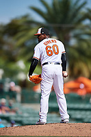 Baltimore Orioles relief pitcher Mychal Givens (60) looks in for the sign during a Grapefruit League Spring Training game against the Tampa Bay Rays on March 1, 2019 at Ed Smith Stadium in Sarasota, Florida.  Rays defeated the Orioles 10-5.  (Mike Janes/Four Seam Images)