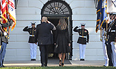 United States President Donald J. Trump salutes the Marine Guards as he and first lady Melania Trump return to the White House after leading a moment of silence in remembrance of those lost on September 11, 2001 on the South Lawn of the White House in Washington, DC on Monday, September 11, 2017.<br /> Credit: Ron Sachs / CNP