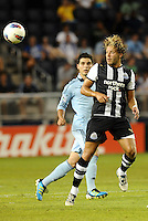 Newcastle United midfielder Alan Smith heads the ball... Sporting Kansas City and Newcastle United played to a 0-0 tie in an international friendly at LIVESTRONG Sporting Park, Kansas City, Kansas.