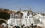 A part of work in Jewish settlement of Harmoun Hanatsave near the Arab neighbourhood of Ras al-Amud in Jerusalem on Oct. 30,2012. The Israeli occupation authority's approved to construct nearly 800 new settlement units in the Jewish Gilo neighborhood south of the city of Jerusalem, after Israeli Prime Minister Benjamin Netanyahu visits the neighborhood where he called for the continuation of settlement activity in the city so that it would remain the ?eternal capital of Israel?. Photo by Mahfouz Abu Turk