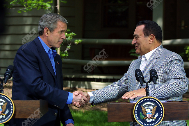 President George W. Bush meets with President Hosni Mubarak of Egypt at Camp David, Maryland, USA, June 8, 2002