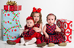 WATERBURY, CT-120218JS01- Christmas Kids, Olivia Thomas, 5-months-old, with her sister Siena Thomas, 2, center, and cousin Gia Busalacchi of Wolcott. <br /> Jim Shannon Republican American