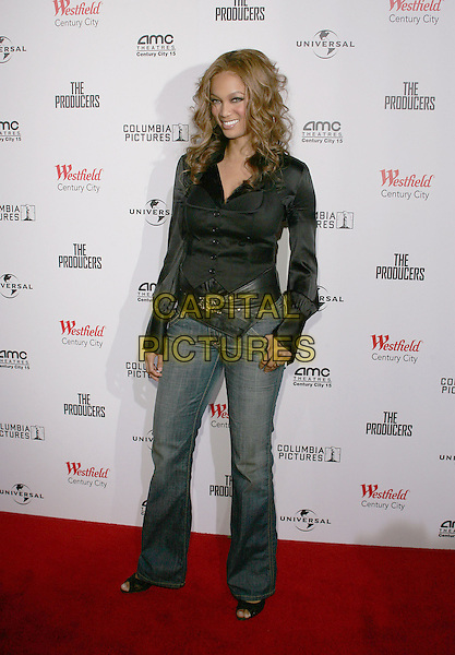 """TYRA BANKS.""""The Producers"""" World Premiere held at the Westfield Century City, Century City, California..December 12th, 2005 .Photo: William Scott/ AdMedia/Capital Pictures.Ref: WS/ADM.full length jeans denim black belt blouse top.www.capitalpictures.com.sales@capitalpictures.com.© Capital Pictures."""