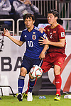 Takashi Inui of Japan (L) fights for the ball with Do Duy Manh of Vietnam (R) during the AFC Asian Cup UAE 2019 Quarter Finals match between Vietnam (VIE) and Japan (JPN) at Al Maktoum Stadium on 24 January 2018 in Dubai, United Arab Emirates. Photo by Marcio Rodrigo Machado / Power Sport Images
