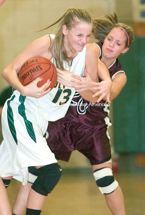 WATERBURY, CT-- 08 JANUARY 2008--010808JS06- Holy Cross' Sarah Herlihy(13) fights off Torrington's Kaylee Cerruto (20) during their game Tuesday at Holy Cross High School in Waterbury. <br /> Jim Shannon/Republican-American