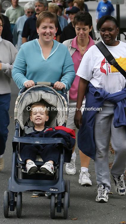 WOODBURY,  CT 25 September 2005 -092505BZ04- Meg Temple, of Southbury, pushes her son Samuel Temple, 3, in a stroller while walking with friend Mumbi Musau, of Woodbury, during the annual CROP walk in Woodbury Sunday morning.<br /> Jamison C. Bazinet / Republican-American