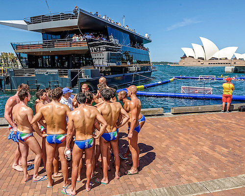 19.12.2015. Italian Head Coach, Allessandro Campagna talks to the team with the pool and Sydney Opera House backdrop prior to the start of the Mens Australia versus Italy International Water Polo match at Campbell's Cove in Sydney, Australia.