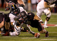 Isi Sofele of California fights for a loose ball against V.J. Fehoko of Utah during the game at Rice-Eccles Stadium in Salt Lake City, Utah on October 27th, 2012.   Utah Utes defeated California, 49-27.