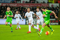 Wayne Routledge of Swansea ( centre ) passes the ball forwards during the Barclays Premier League match between Swansea City and Sunderland played at the Liberty Stadium, Swansea  on  January the 13th 2016